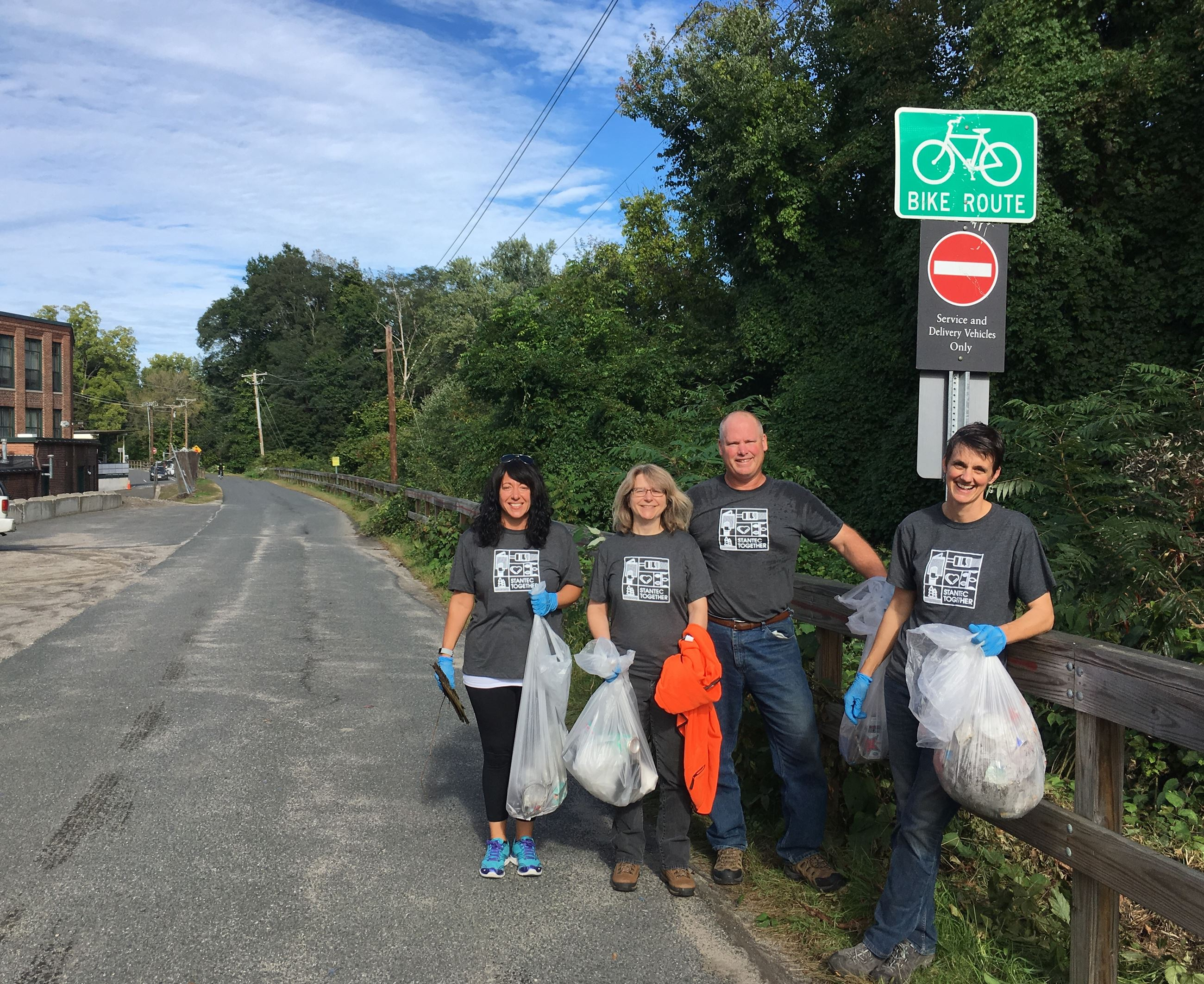 Stantec volunteers cleaning up the bike path