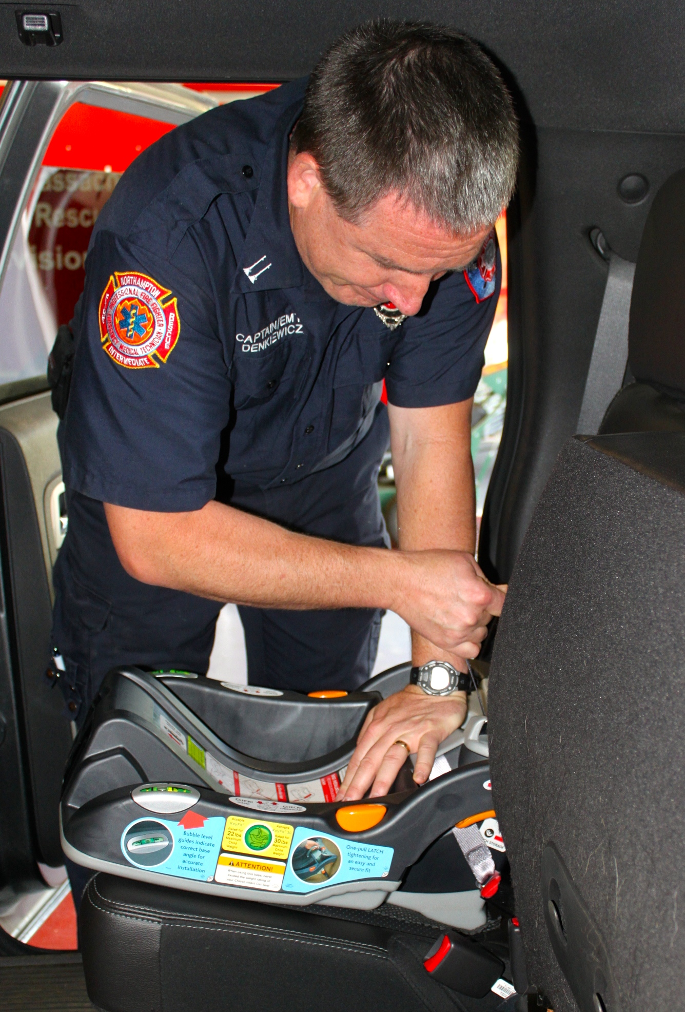 Police Officer Inspecting Car Seat