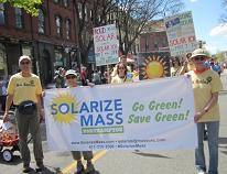 "Parade Carrying ""Solarize Mass"" Banner"
